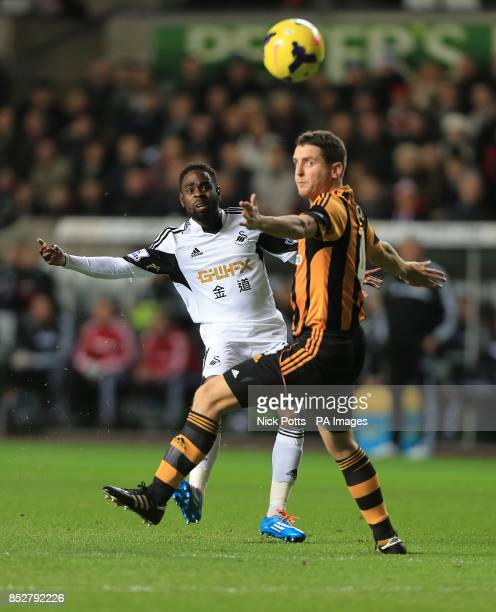 Hull City's Alex Bruce and Swansea City's Nathan Dyer battle for the ball