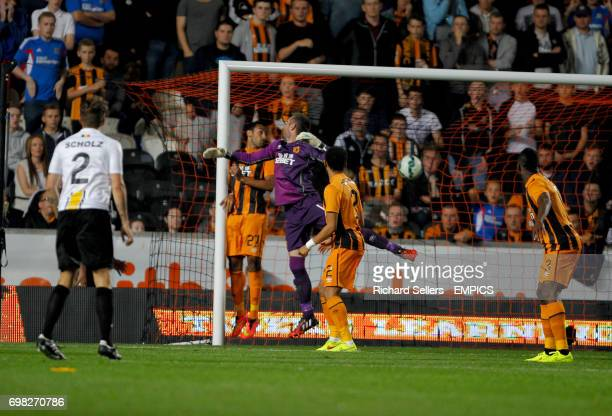 Hull City's Allan McGregor looks back as Lokeren's Jordan Remacle scores