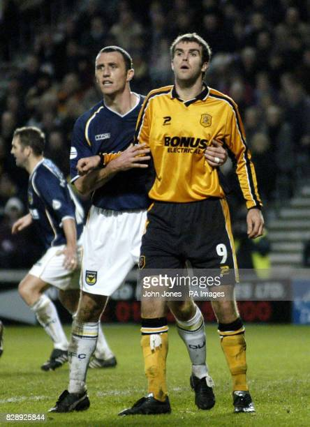 Hull City's Ben Burgess and Oxford's Andy Crosby during their Nationwide Division Three match at Hull's Kingston Communications Stadium. Hull won...