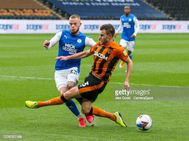 Hull City's Callum Elder slides in on Peterborough United's Joe Ward during the Sky Bet League One match between Hull City and Peterborough United at...