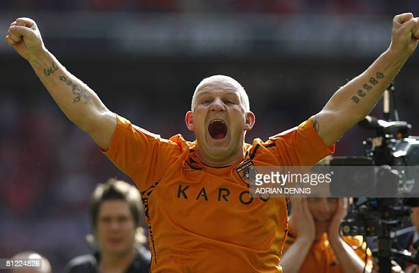 Hull City's Dean Windass reacts in front of fans while celebrating his team's victory over Bristol City during the Football League Championship...