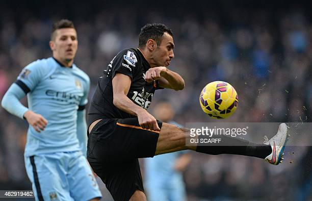 Hull City's Egyptian midfielder Ahmed Elmohamady clears the ball from Manchester City's Montenegrin striker Stevan Jovetic during the English Premier...