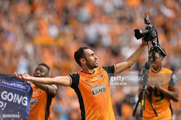 Hull City's Egyptian midfielder Ahmed Elmohamady poses to take a selfie with a media photographer's pitchside remote camera during the English...