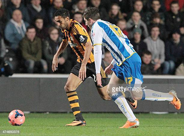 Hull City's Egyptian midfielder Ahmed Elmohamady vies for the ball against Brighton and Hove Albion's Irish defender Stephen Ward during an English...