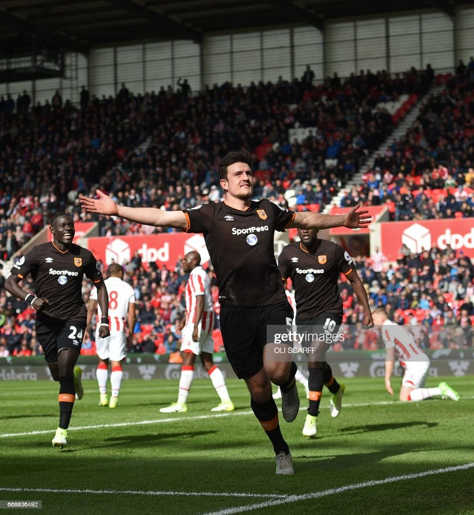 Hull City's English defender Harry Maguire celebrates scoring Hull's first goal during the English Premier League football match between Stoke City and Hull City at the Bet365 Stadium in Stoke-on-Trent, central England on April 15, 2017. / AFP PHOTO / Oli SCARFF / RESTRICTED TO EDITORIAL USE. No use with unauthorized audio, video, data, fixture lists, club/league logos or 'live' services. Online in-match use limited to 75 images, no video emulation. No use in betting, games or single club/league/player publications. /
