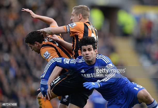 Hull City's English defender Michael Dawson and Hull City's Northern Irish defender Alex Bruce vie with Chelsea's Brazilianborn Spanish striker Diego...