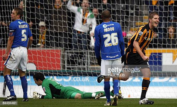 Hull City's English defender Michael Turner celebrates scoring during their English FA Cup football match against Millwall at The Kingston...