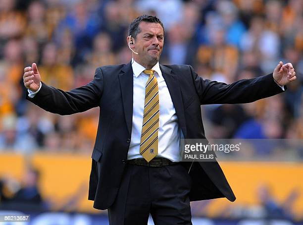 Hull City's English manager Phil Brown appeals to the fourth official after Hull gave away a free kick that led to a Liverpool goal during the...