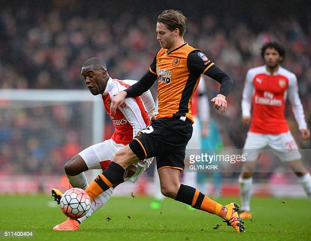 Hull City's English midfielder Nick Powell holds off Arsenal's Costa Rican striker Joel Campbell during the FA cup fifth round football match between...