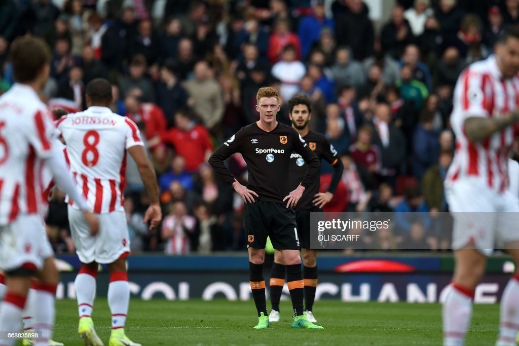 Hull City's English midfielder Sam Clucas (CL) and Hull City's Italian defender Andrea Ranocchia (CR) react to conceding Stoke City's third goal during the English Premier League football match between Stoke City and Hull City at the Bet365 Stadium in Stoke-on-Trent, central England on April 15, 2017. / AFP PHOTO / Oli SCARFF / RESTRICTED TO EDITORIAL USE. No use with unauthorized audio, video, data, fixture lists, club/league logos or 'live' services. Online in-match use limited to 75 images, no video emulation. No use in betting, games or single club/league/player publications. /