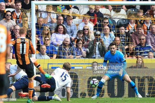 Hull City's English midfielder Sam Clucas scores his team's first goal past Tottenham Hotspur's French goalkeeper Hugo Lloris during the English...