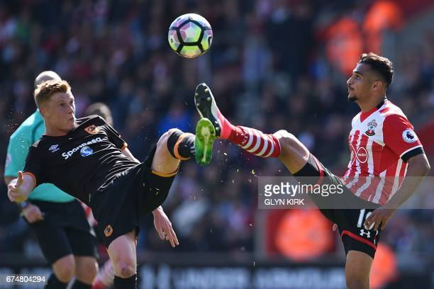 Hull City's English midfielder Sam Clucas vies with Southampton's Moroccan midfielder Sofiane Boufal during the English Premier League football match...
