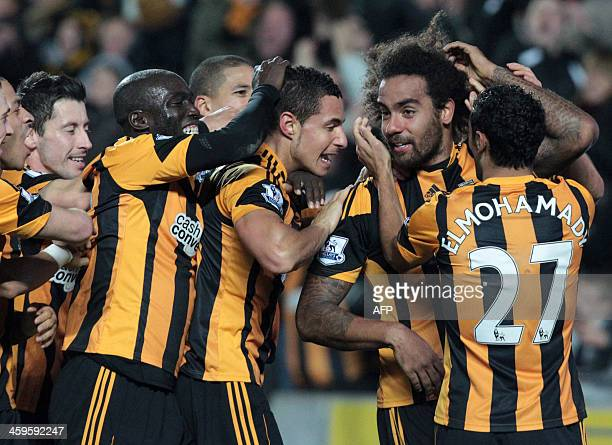 Hull City's English midfielder Tom Huddlestone celebrates scoring their fourth goal with teammates during the English Premier League football match...