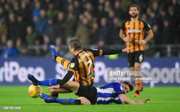 Hull City's Evandro Goebel is tackled by Sheffield Wednesday's Sam Hutchinson during the Sky Bet Championship match between Hull City and Sheffield...