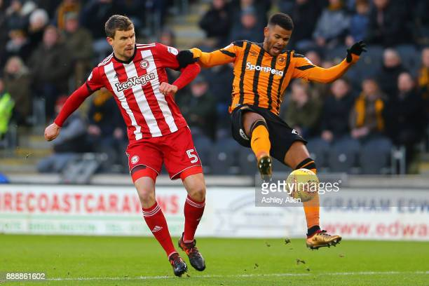 Hull City's Fraizer Campbell and Andreas Bjelland battle for control of the ball during the Sky Bet Championship match between Hull City and...