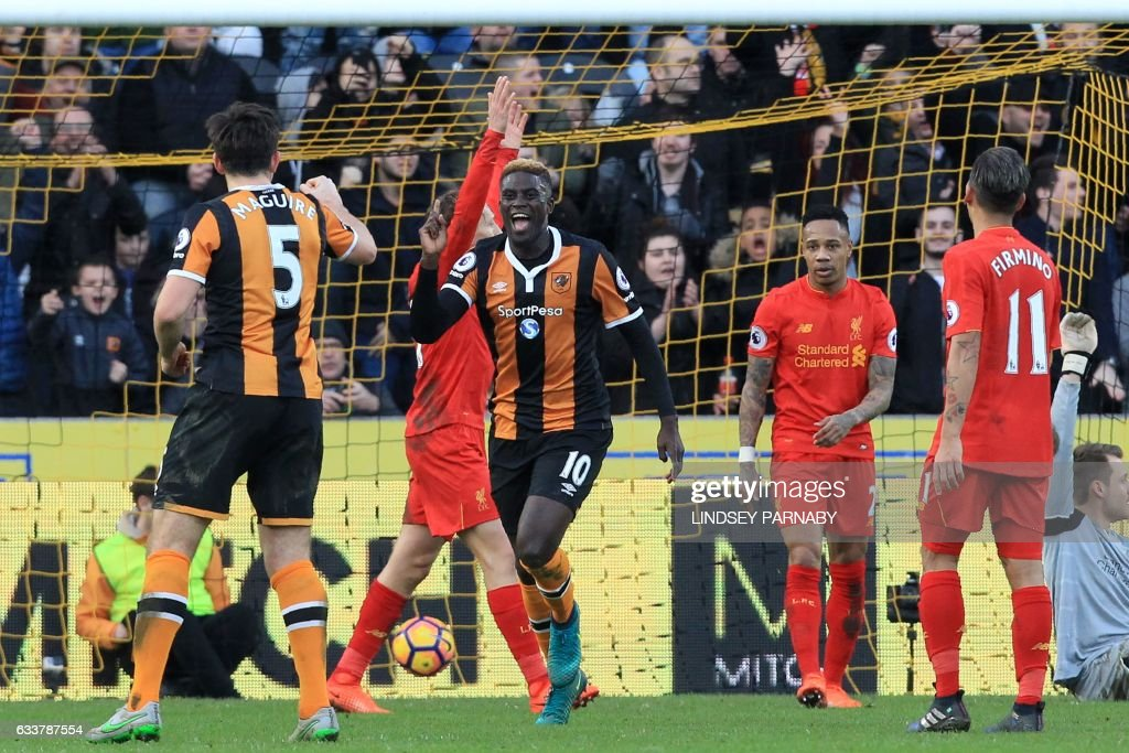 Hull City's French midfielder Alfred N'Diaye (C) celebrates after scoring the opening goal of the English Premier League football match between Hull City and Liverpool at the KCOM Stadium in Kingston upon Hull, north east England on February 4, 2017. / AFP / Lindsey PARNABY / RESTRICTED TO EDITORIAL USE. No use with unauthorized audio, video, data, fixture lists, club/league logos or 'live' services. Online in-match use limited to 75 images, no video emulation. No use in betting, games or single club/league/player publications. /