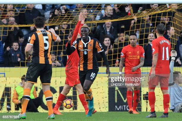Hull City's French midfielder Alfred N'Diaye celebrates after scoring the opening goal of the English Premier League football match between Hull City...