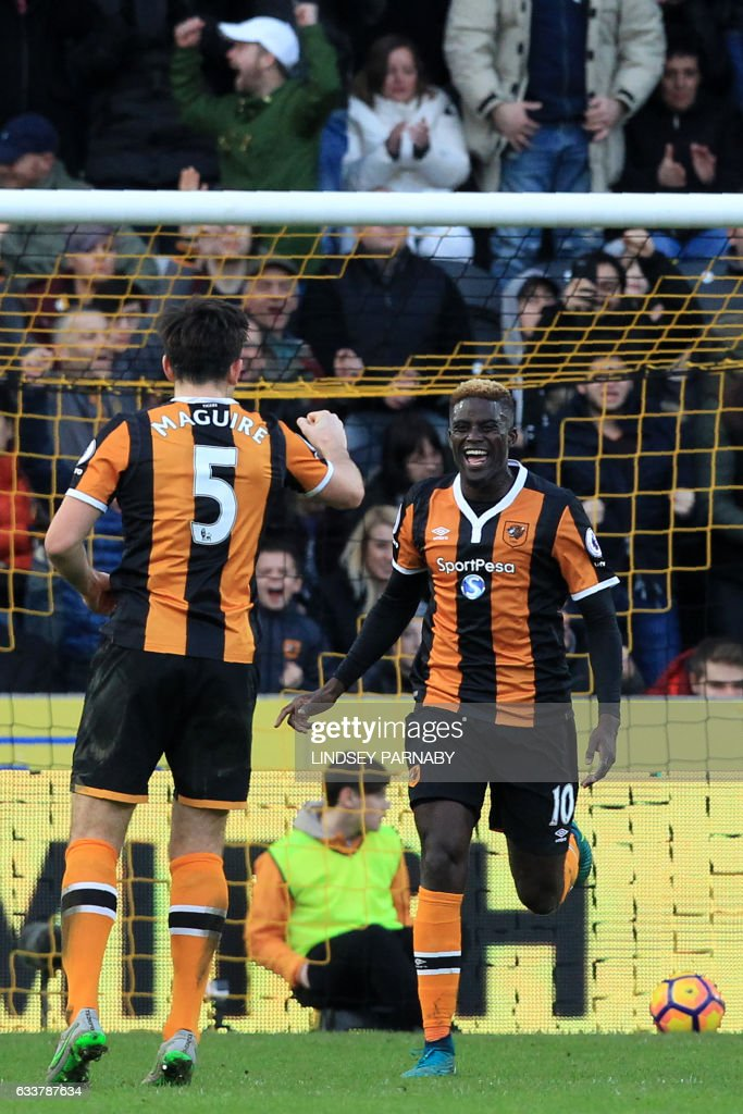 Hull City's French midfielder Alfred N'Diaye (R) celebrates with Hull City's English defender Harry Maguire (L) after scoring the opening goal of the English Premier League football match between Hull City and Liverpool at the KCOM Stadium in Kingston upon Hull, north east England on February 4, 2017. / AFP / Lindsey PARNABY / RESTRICTED TO EDITORIAL USE. No use with unauthorized audio, video, data, fixture lists, club/league logos or 'live' services. Online in-match use limited to 75 images, no video emulation. No use in betting, games or single club/league/player publications. /