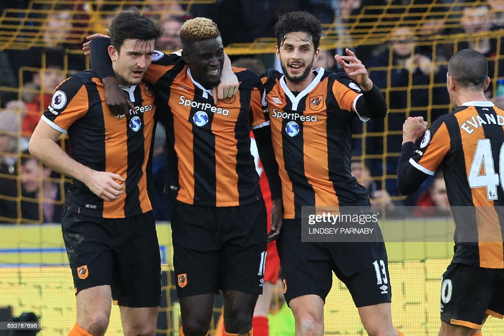 Hull City's French midfielder Alfred N'Diaye (2nd L) celebrates with teammates after scoring the opening goal of the English Premier League football match between Hull City and Liverpool at the KCOM Stadium in Kingston upon Hull, north east England on February 4, 2017. / AFP / Lindsey PARNABY / RESTRICTED TO EDITORIAL USE. No use with unauthorized audio, video, data, fixture lists, club/league logos or 'live' services. Online in-match use limited to 75 images, no video emulation. No use in betting, games or single club/league/player publications. /