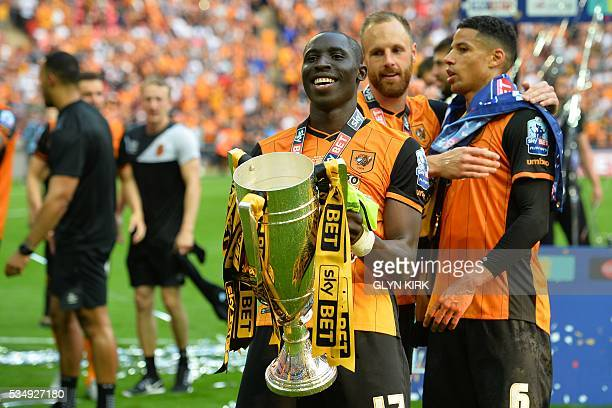 Hull City's Frenchborn Senegalese midfielder Mohamed Diame lifts the trophy during the presentation after Hull City won the English Championship...