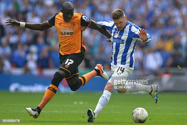 Hull City's Frenchborn Senegalese midfielder Mohamed Diame vies with Sheffield Wednesday's English striker Gary Hooper during the English...