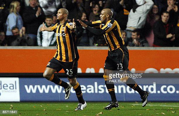 Hull City's French-Gabonese forward Daniel Cousin celebrates after scoring against Manchester City with Hull City's Jamaican forward Marlon King...