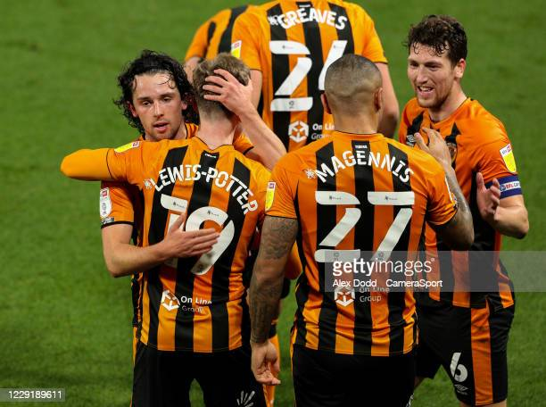 Hull City's George Honeyman hugs Keane LewisPotter after he scored deep into time added on in the first half during the Sky Bet League One match...