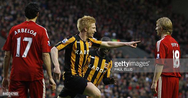 Hull City's Irish defender Paul McShane celebrates scoring the opening goal against Liverpool during their English Premier League football match at...