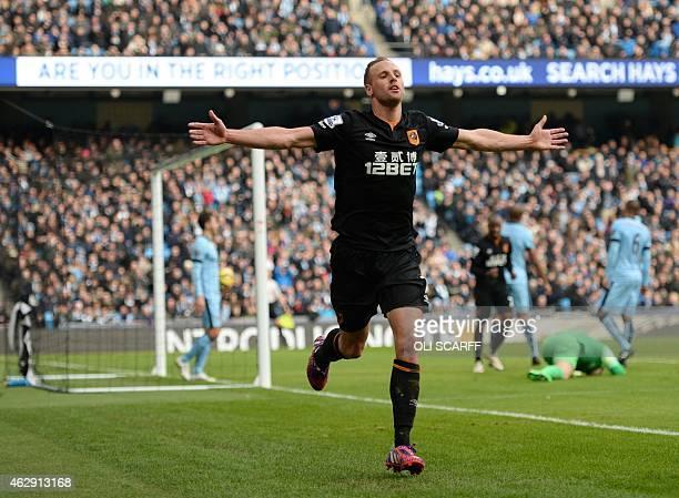 Hull City's Irish midfielder David Meyler celebrates scoring his team's first goal during the English Premier League football match between...