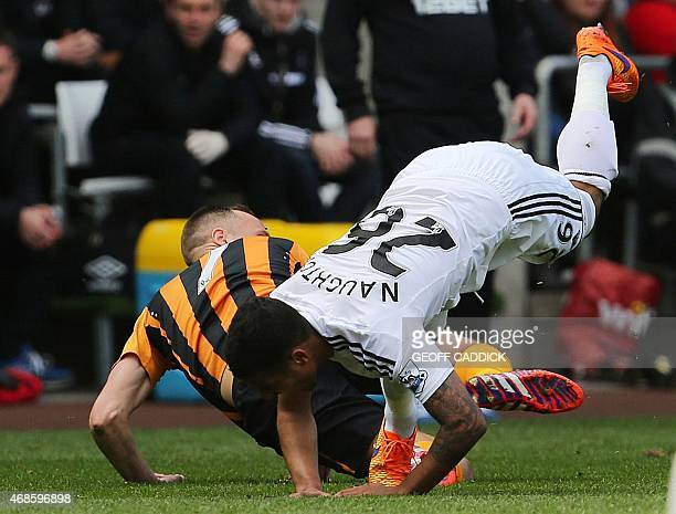 Hull City's Irish midfielder David Meyler is sent off for this tackle on Swansea City's English defender Kyle Naughton during the English Premier...