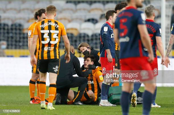 Hull City's Jacob Greaves receives treatment for an injury sustained in a challenge from Sunderland's Charlie Wyke during the Sky Bet League One...