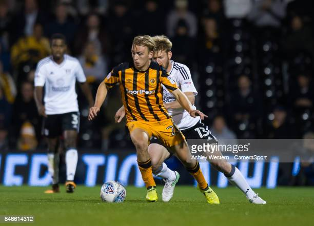 Hull City's Jarrod Bowen holds off the challenge from Fulham's Tim Ream during the Sky Bet Championship match between Fulham and Hull City at Craven...