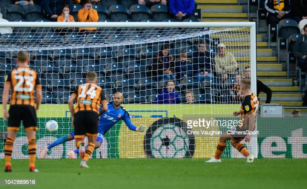 Hull City's Jarrod Bowen scores his side's equalising goal as he sends Middlesbrough's Darren Randolph the wrong way from the penalty spot to make...