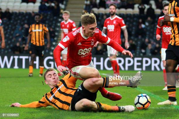 Hull City's Jarrod Bowen tackles Nottingham Forest's Matt Mills during the Emirates FA Cup Fourth Round match between Hull City and Nottingham Forest...