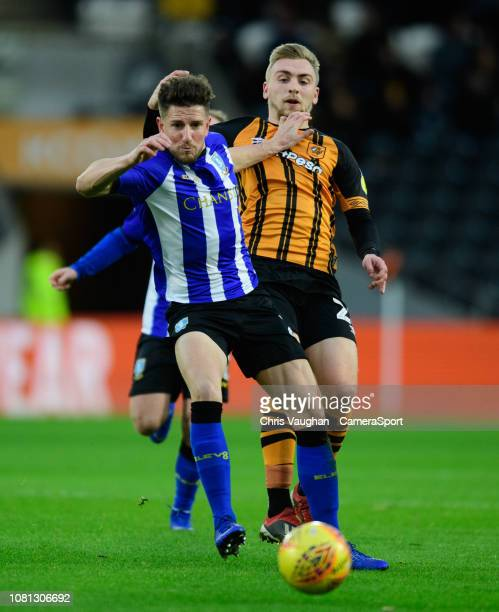 Hull City's Jarrod Bowen vies for possession with Sheffield Wednesday's Sam Hutchinson during the Sky Bet Championship match between Hull City and...