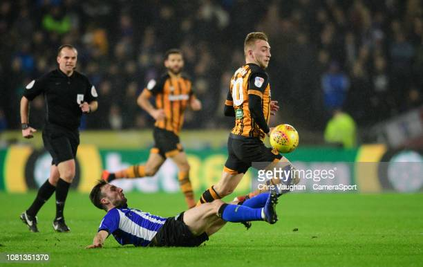 Hull City's Jarrod Bowen vies for possession with Sheffield Wednesday's Morgan Fox during the Sky Bet Championship match between Hull City and...