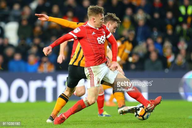 Hull City's Jarrod Bowen wins the ball from Nottingham Forest Ben Osborn during the Emirates FA Cup Fourth Round match between Hull City and...