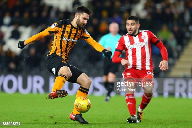 Hull City's Jon Toral wins control of the ball from Brentford's Neal Maupay during the Sky Bet Championship match between Hull City and Brentford at...