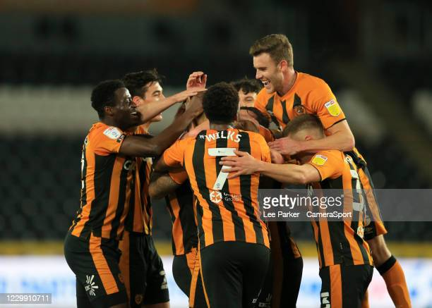 Hull City's Josh Magennis is mobbed by his team mates after he scores his sides first goal in the 26th minute with Hakeeb Adelakun Mallik Wilks and...