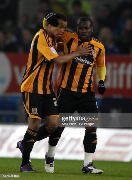 Hull City's Joshua King and Aaron King celebrate the own goal scored by Cardiff City defender Kevin McNaughton during the npower Football League...