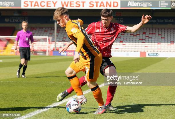 Hull City's Keane Lewis-Potter under pressure from Lincoln City's Conor McGrandles during the Sky Bet League One match between Lincoln City and Hull...