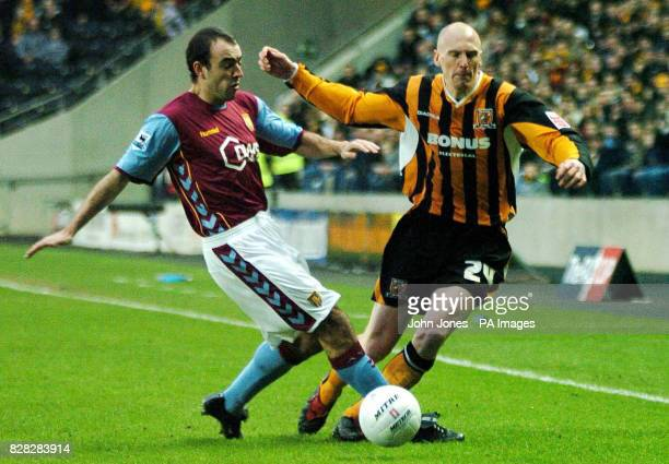 Hull City's Kevin Ellison is tackled by Aston Villa's Gavin McCann during the FA Cup Third Round at Kingston Communications Stadium, Hull, Saturday...