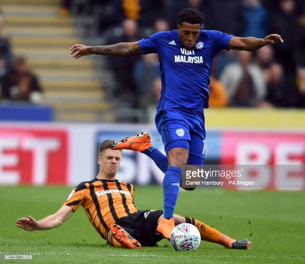 Hull City's Markus Henriksen and Cardiff City's Nathaniel MendezLaing battle for the ball during the Sky Bet Championship match at the KCOM Stadium...