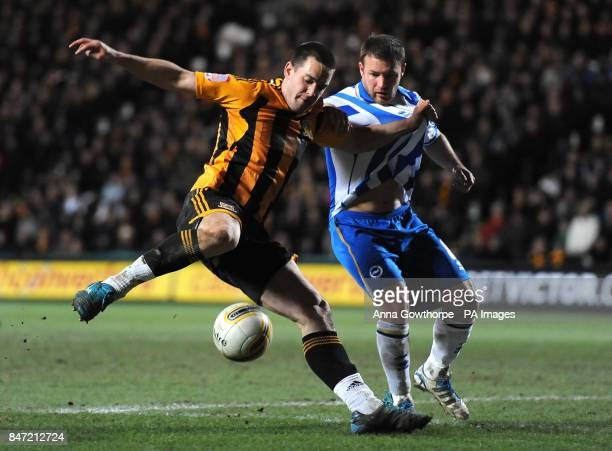 Hull City's Matty Fryatt and Brighton Hove Albion's Alan Navarro battle for the ball during the npower Football League Championship match at the KC...