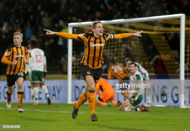 Hull City's Michael Dawson celebrates after he scores hulls equaliser during the Sky Bet Championship match between Hull City and Barnsley at KCOM on...