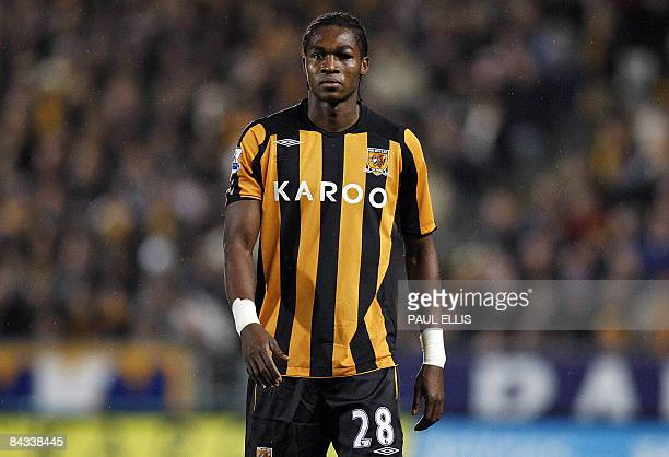 Hull City's new signing, Angolan forward Manucho shows an eye injury during their English Premier League football match against Arsenal on January...