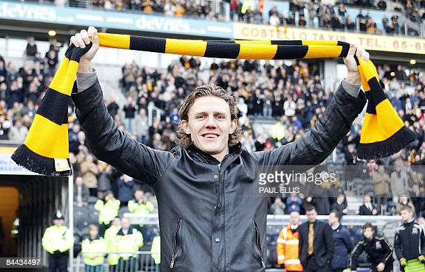 Hull City's new signing, Jimmy Bullard, who signed from Fulham for a club record fee of £5million is unveiled before their English FA Cup football...