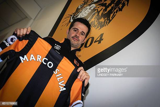 Hull City's newlyappointed Portuguese head coach Marco Silva poses for a photograph with a Hull City shirt at their Hull City AFC training ground in...
