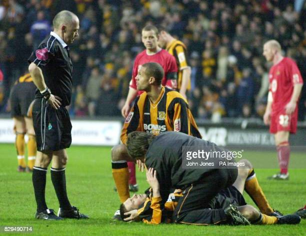 Hull City's Nick Barmby receives treatment for an injury that saw him stretchered from the pitch as concerned team mate Junior Lewis looks on