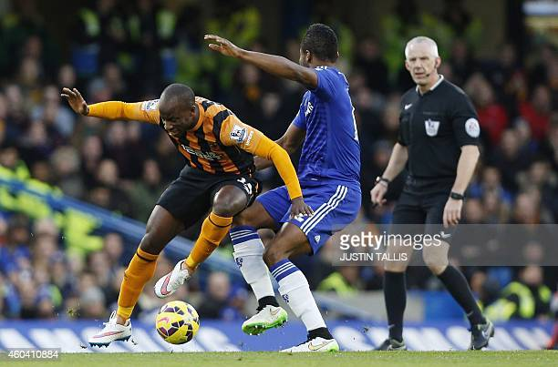 Hull Citys Nigerian midfielder Sone Aluko and Chelsea's Nigerian midfielder John Obi Mikel go in for the ball under the eye of referee Chris Foy...